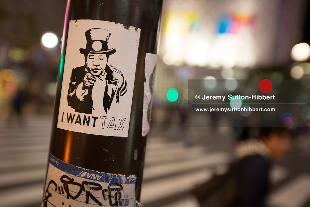 'I Want Tax' sticker, (depicting illustration of Prime MInister Noda of Japan), by the designer known as '281 Anti Nuke' in Shibuya district of Tokyo, Japan on Monday 16th April 2012. The activist designer places his stickers protesting the nuclear industry, with anti-TEPCO and anti-nuclear imagery, in aftermath of the 2011 Fukushima nuclear disaster, in public areas across Tokyo.