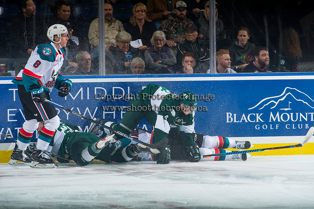 KELOWNA, CANADA - SEPTEMBER 29: Jack Cowell #8 and Gordie Ballhorn #4 of the Kelowna Rockets get tangled at the boards with Ian Walker #4 of the Everett Silvertips on September 29, 2017 at Prospera Place in Kelowna, British Columbia, Canada.  (Photo by Marissa Baecker/Shoot the Breeze)  *** Local Caption ***