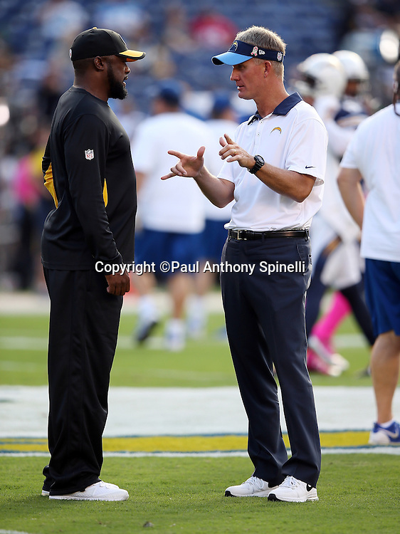 Pittsburgh Steelers head coach Mike Tomlin (left) talks to San Diego Chargers head coach Mike McCoy before the 2015 NFL week 5 regular season football game against the San Diego Chargers on Monday, Oct. 12, 2015 in San Diego. The Steelers won the game 24-20. (©Paul Anthony Spinelli)