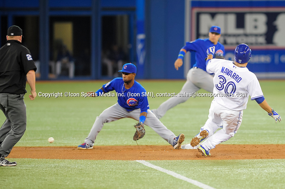 Sep 10 2014: Toronto Blue Jays catcher Dioner Navarro (30) steals 2nd base in the 5th inning. The Toronto Blue Jays defeated the Chicago Cubs 11 - 1 at the Rogers Centre, Toronto Ontario.