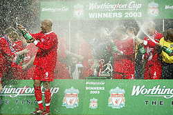 CARDIFF, WALES - Sunday, March 2, 2003: Liverpool celebrate with champagne after beating Manchester United 2-0 to win the Worthington League Cup at the Millennium Stadium. (Pic by David Rawcliffe/Propaganda)