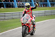 Shane Shakey Byrne (67) BeWiser Ducati waving to the crowd after gaining pole position for race 1 at the BSB Championship at the TT Circuit,  Assen, Netherlands on 1 October 2016. Photo by Nigel Cole.