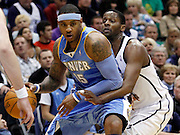 Denver Nuggets forward Carmelo Anthony (15) is defended by Utah Jazz forward C.J. Miles, right, during the first half of Game 6 of the NBA Western Conference first-round playoff series in Salt Lake City, Friday, April 30, 2010. (AP Photo/Colin E Braley)