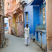 Man walking in laneway in village in Rajasthan