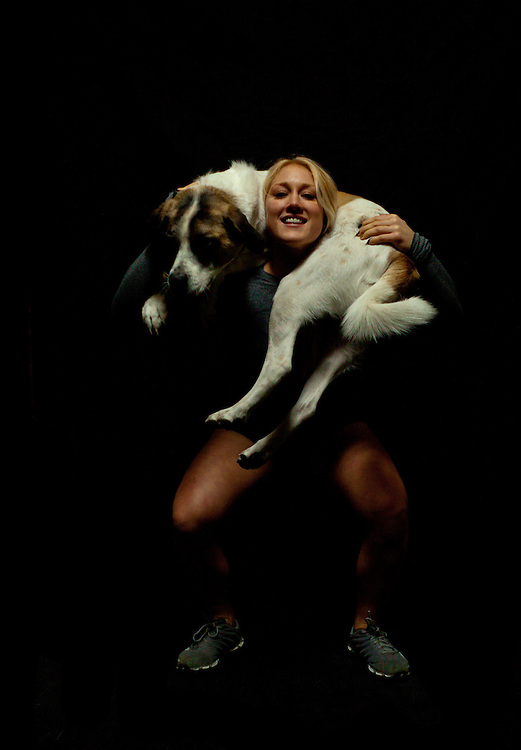 Jaelyn Wolf squats her dog Chance, Crossfit image, picture, photo, photography of health, elite, exercise, training, workouts, WODs, taken at Progressive Fitness CrossFit,Colorado Springs, Colorado, USA.