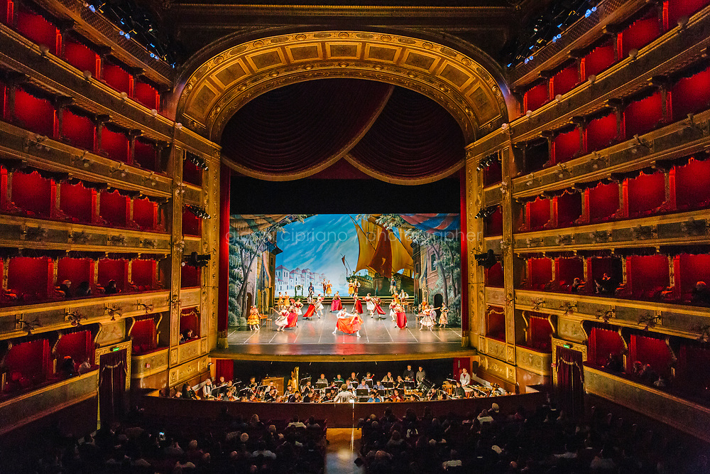 PALERMO, ITALY - 18 FEBRUARY 2018: The dress rehearsal of &quot;Don Quixote&quot; is seen here from the Royal Box of the Teatro Massimo in Palermo, Italy, on February 18th 2018.<br /> <br /> The Teatro Massimo Vittorio Emanuele is an opera house and opera company located  in Palermo, Sicily. It was dedicated to King Victor Emanuel II. It is the biggest in Italy, and one of the largest of Europe (the third after the Op&eacute;ra National de Paris and the K. K. Hof-Opernhaus in Vienna), renowned for its perfect acoustics. It was inaugurated in 1897.