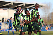 AFC Wimbledon striker Tom Elliott (9) scores the winning goal 3-4 and celebrates with AFC Wimbledon defender Jon Meades (3) and AFC Wimbledon striker Dominic Poleon (10) during the The FA Cup match between Curzon Ashton and AFC Wimbledon at Tameside Stadium, Ashton Under Lyne, United Kingdom on 4 December 2016. Photo by Stuart Butcher.