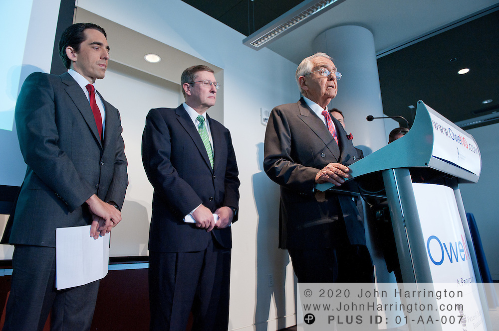 """Chairman of the Peter G. Peterson Foundation Peter G. Peterson (at podium) speaks as his son, Vice Chairman Micheal A. Peterson (far left), and U.S. Senate Budget Committee Chairman Kent Conrad (middle) look on at the press conference launching the """"OweNo"""" campaign at the Newseum in Washington D.C. on November 9th, 2010. The goal of the campaign is to create an effective bipartisan movement to find solutions to the country's fiscal challenges."""