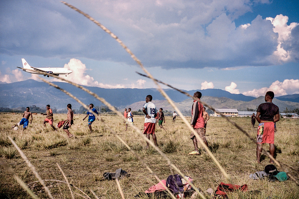 Young Papuans play soccer in an empty field near the airport in Wamena.