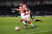 Doncaster Rovers defender Cedric Evina goes past Stoke City midfielder, on loan from Chelsea, Marco van Ginkel   during the The FA Cup third round match between Doncaster Rovers and Stoke City at the Keepmoat Stadium, Doncaster, England on 9 January 2016. Photo by Simon Davies.