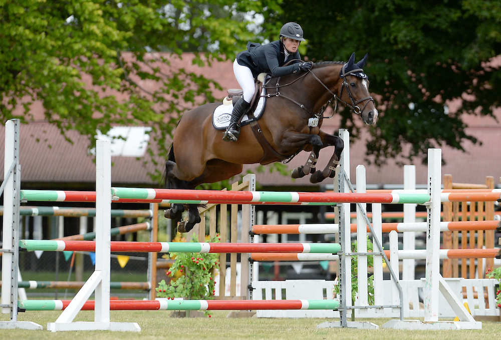 Natasha Brooks rides Kapattack to win the Ultra-mox World Cup Qualifier, Central and Southern Hawke's Bay North Island Showjumping Championship, Dannevirke Show Grounds, Dannevirke, Sunday, January 10, 2015. Credit: SNPA / Sarah Alderman