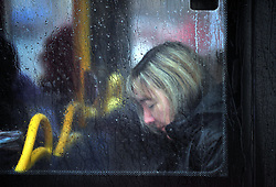 &copy; Licensed to London News Pictures. 6/06/2017<br /> A commuter on a bus.<br /> Heavy rain and some flooding this morning in Kent and the South East,UK. Shoppers and commuters get wet in Orpington High Street as the roads start to flood.<br /> Photo credit: Grant Falvey/LNP