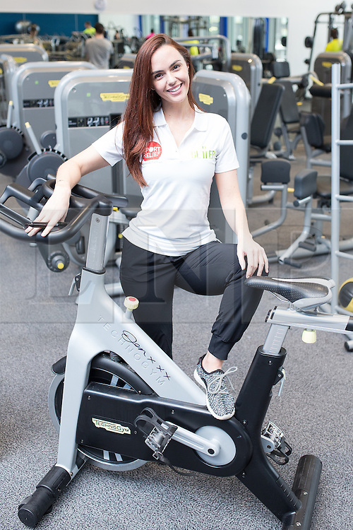 """© Licensed to London News Pictures . 01/03/2016 . Manchester , UK . Hollyoaks actress JENNIFER METCALFE (pictured posing on a bike she's signed for a competition) launches a national fundraiser , """" The Better Bike Challenge """" from the East Manchester Leisure Centre in Beswick . The Challenge features 10,000 people cycling one-mile , each donating £1 to #TeamBetter for Sport Relief . Photo credit : Joel Goodman/LNP"""