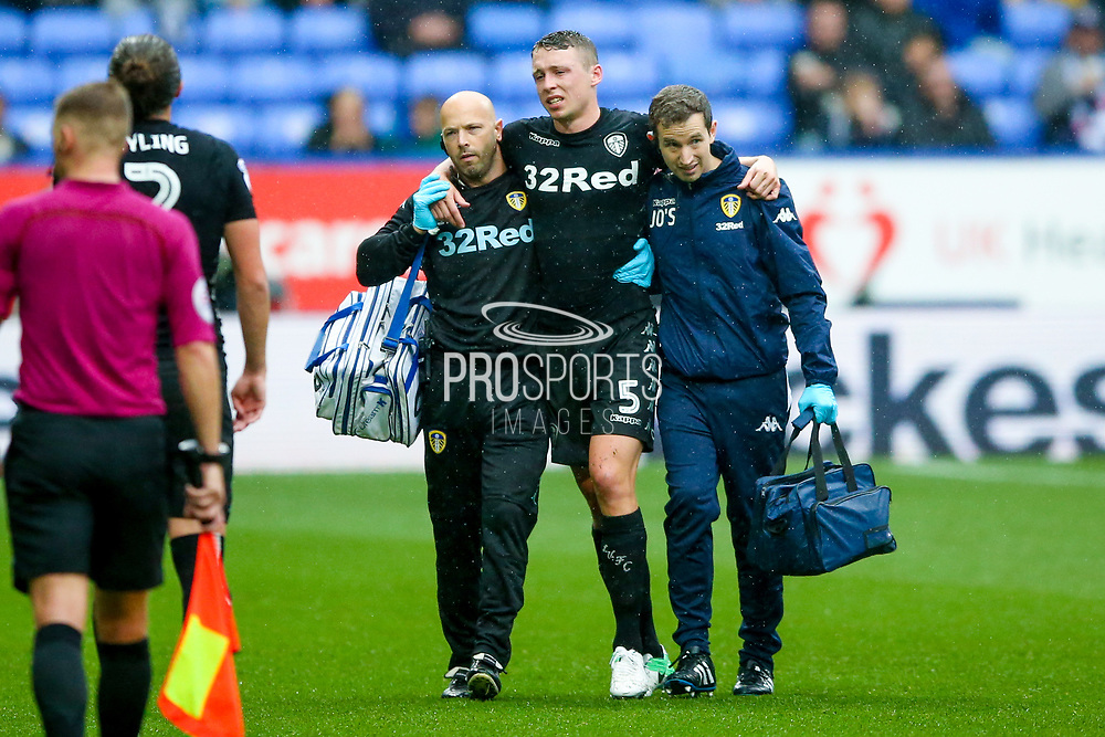 Leeds United defender Matthew Pennington (5), on loan from  Everton, has to go off injured during the EFL Sky Bet Championship match between Bolton Wanderers and Leeds United at the Macron Stadium, Bolton, England on 6 August 2017. Photo by Simon Davies.