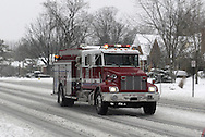 A Kettering, Ohio Fire truck on the way to help during a snowfall in Dayton, Ohio, Saturday, December 15, 2007.