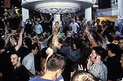 People dancing in a club. Ibiza 1999.