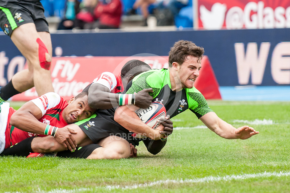 2 Kenyan defenders can't stop Wales' Luke Morgan powering over the try line. Action from the IRB Emirates Airline Glasgow 7s at Scotstoun in Glasgow. 3 May 2014. (c) Paul J Roberts / Sportpix.org.uk