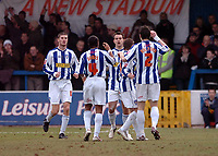 Photo: Kevin Poolman.<br />Colchester United v Bradford City. Coca Cola League 1. 04/02/2006. <br />Colchester players celebrate their first goal.