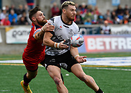 Blake Wallace of Toronto Wolfpack  offloads the ball despite the tackle of Jarrod Sammut (L) of London Broncos during the Super 8s Qualifiers Million Pound Game at Lamport Stadium, Toronto, Canada<br /> Picture by Stephen Gaunt/Focus Images Ltd +447904 833202<br /> 07/10/2018