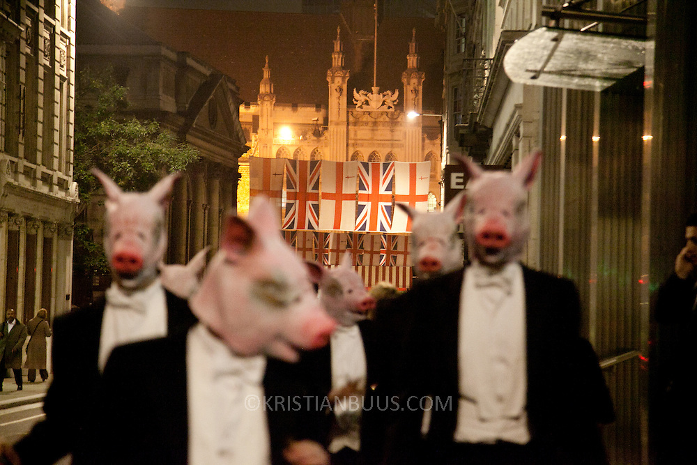 "8 men dressed in tuxedos and wearing pigs heads tried to join the Lord Mayor's Banquet in London, pointing out that the banquet is for the 1 % of society and not the 99%. ""The 8 distinguished members of the Willindon club were then forced to seek sustenance at Occupy LSX."