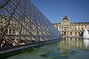 Glass pyramid by I. M. Pei in 1989, rising from the centre of the Cour Napoléon, Pavillon Sully by Jacques Lemercier in 1639 in the background, Louvre Museum, Paris, France. Picture by Manuel Cohen