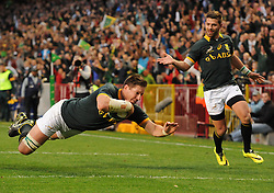 Image ©Licensed to i-Images Picture Agency. 07/06/2014. CAPE TOWN, SOUTH AFRICA -  Bakkies Botha of South Africa dives over the try line during the Castle Lager Incoming Series rugby tour match between the Springboks and the World XV at Newlands rugby stadium. Picture by Roger Sedres / i-Images