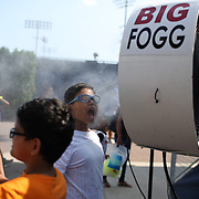 2017 U.S. Open - AUGUST 26. Young fans stay cool under  a big fogg water spray during Arthur Ashe kids day at the US Open Tennis Tournament at the USTA Billie Jean King National Tennis Center on August 26, 2017 in Flushing, Queens, New York City.  (Photo by Tim Clayton/Corbis via Getty Images)
