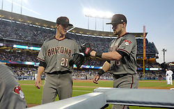 April 14, 2017 - Los Angeles, California, U.S. - Arizona Diamondbacks starting pitcher Zack Greinke high fives teammate shortstop Chris Owings after he made a catch to end the first inning of a Major League baseball game against the Los Angeles Dodgers at Dodger Stadium on Friday, April 14, 2017 in Los Angeles. (Photo by Keith Birmingham, Pasadena Star-News/SCNG) (Credit Image: © San Gabriel Valley Tribune via ZUMA Wire)