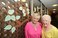 HATBORO, PA - SEPTEMBER 04: Ruth DiEva (L) and Mary Bachman pose with the tree that was painted on a church window by a congregation member, Rachel Moore (NOT SHOWN) September 4, 2014 at St John's Lutheran Church in Hatboro, Pennsylvania. The church is celebrating its 65th anniversary this month.<br /> (Photo by William Thomas Cain/Cain Images)