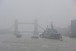 © Licensed to London News Pictures. 11/05/2016. LONDON, UK.  Tower Bridge and HMS Belfast on the River Thames are shrouded in fog during foggy and wet weather this morning.  Photo credit: Vickie Flores/LNP