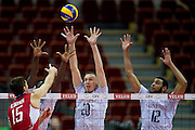 (L-R) Mory Sidibe and Kevin Le Roux and Earvin Ngapeth block against Dmitriy Ilinykh from Russia during the 2013 CEV VELUX Volleyball European Championship match between Russia v France at Ergo Arena in Gdansk on September 25, 2013.<br /> <br /> Poland, Gdansk, September 25, 2013<br /> <br /> Picture also available in RAW (NEF) or TIFF format on special request.<br /> <br /> For editorial use only. Any commercial or promotional use requires permission.<br /> <br /> Mandatory credit:<br /> Photo by &copy; Adam Nurkiewicz / Mediasport