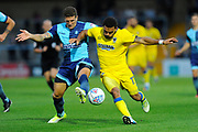 Adam El-Abd (6) of Wycombe Wanderers battles for the ball with Andy Barcham (17) of AFC Wimbledon during the Pre-Season Friendly match between Wycombe Wanderers and AFC Wimbledon at Adams Park, High Wycombe, England on 25 July 2017. Photo by Graham Hunt.