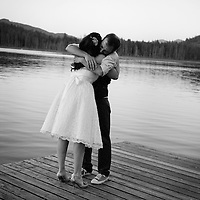 Damian and Lynn hug after their Maple Ridge wedding at Whonnock Lake.