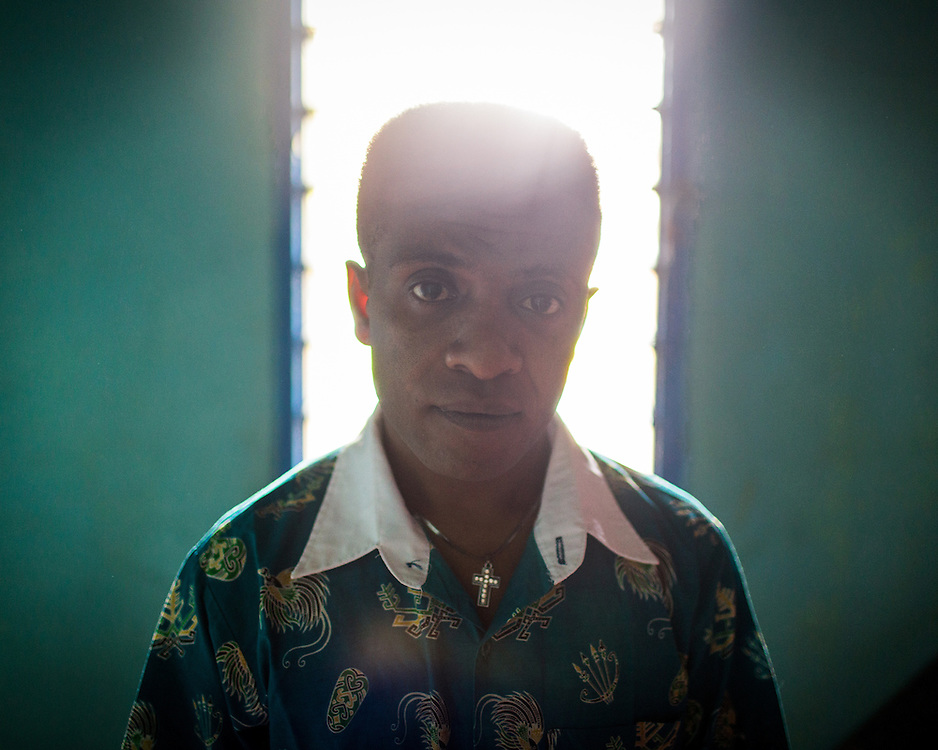 A portrait of Yosua as he prepares to go to church on Sunday morning. For more information and to watch multimedia please visit this interactive website: <br /> <br /> www.Iampositif.org (English)<br /> www.Sayapositif.org (Indonesian)