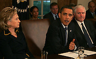 President Barack Obama speaks at a cabinet meeting on November 23rd 2009 in Washington, DC. left to right: Secretary Hillary Rodham Clinton, President Obama, Secretary Robert Gates.  photo by Dennis Brack