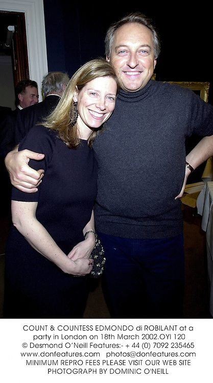 COUNT & COUNTESS EDMONDO di ROBILANT at a party in London on 18th March 2002.OYI 120