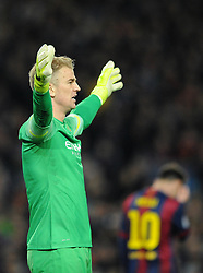 Manchester City's Joe Hart shouts at his defence as Barcelona's Lionel Messi cuts a dejected figure - Photo mandatory by-line: Dougie Allward/JMP - Mobile: 07966 386802 - 18/03/2015 - SPORT - Football - Barcelona - Nou Camp - Barcelona v Manchester City - UEFA Champions League - Round 16 - Second Leg