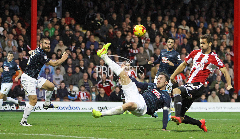 Derby County Richard Keogh clears with an overhead kick during the Sky Bet Championship match between Brentford and Derby County at Griffin Park, London, England on 1 November 2014.