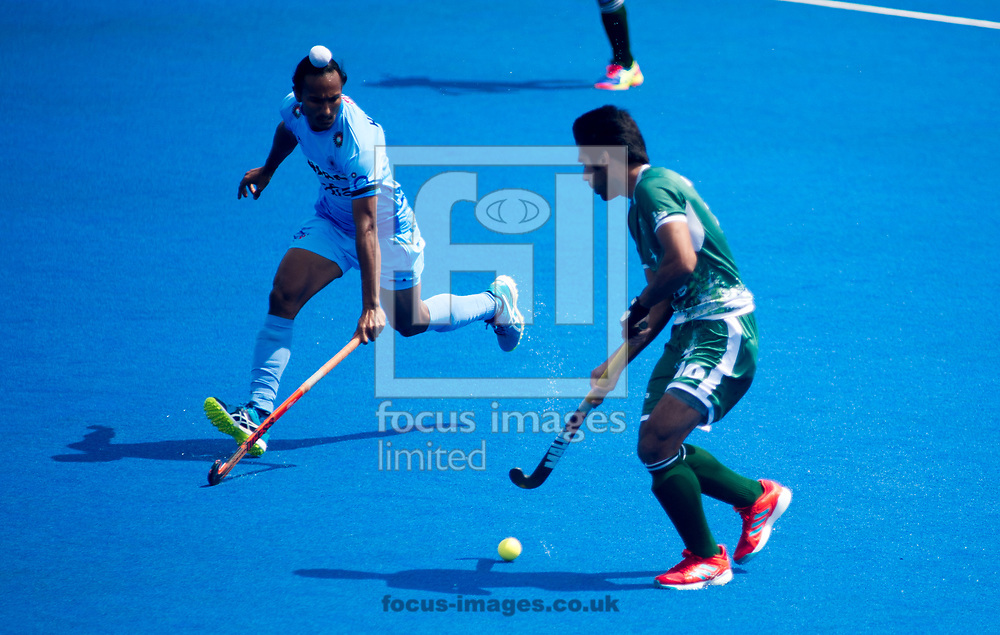 Abu Mahmood of Pakistan and Talwinder Singh of India battle for the ball on day four of the Men's Hero Hockey World League Semi-Finals at Lee Valley Hockey Centre, Stratford<br /> Picture by Hannah Fountain/Focus Images Ltd 07814482222<br /> 18/06/2017