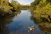 People kayaking on the Colorado river in Austin, Texas