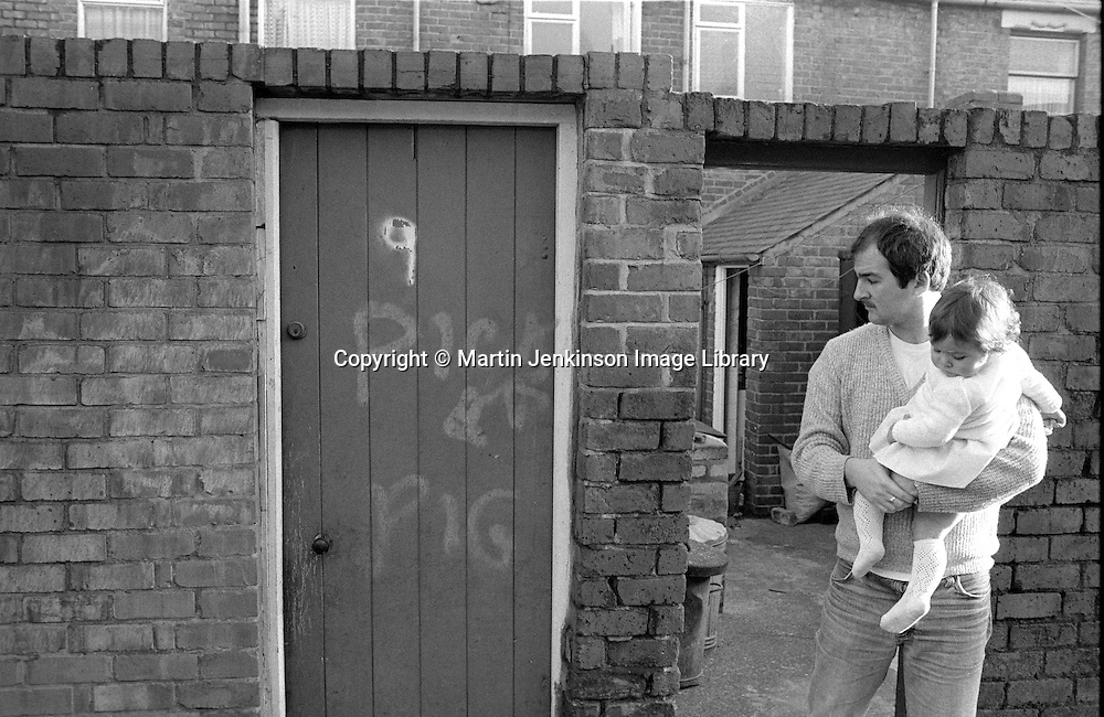 Shaun Johnson an  Ellington striker looks at the anti strike graffiti on his back gate. 06/12/1984.