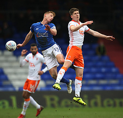 Eoin Doyle of Oldham Athletic (L) and Daniel Philliskirk of Blackpool in action - Mandatory by-line: Jack Phillips/JMP - 02/04/2018 - FOOTBALL - Sportsdirect.com Park - Oldham, England - Oldham Athletic v Blackpool - Football League One