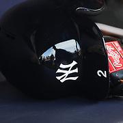 Derek Jeter, New York Yankees, reflected in his batting helmet in the dugout before the New York Yankees Vs Cincinnati Reds baseball game at Yankee Stadium, The Bronx, New York. 18th July 2014. Photo Tim Clayton