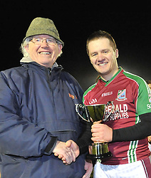Shrule-Glencorrib's Captain Cian Donnellan accepts the South Mayo Junior B trophy from Billy Horan after victory over Garrymore in Ballinrobe friday night last.<br /> Pic Conor McKeown