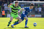 Forest Green Rovers defender Mark Ellis (5) holds up North Ferriby United forward Reece Thompson (25) 0-0 during the Vanarama National League match between Forest Green Rovers and North Ferriby United at the New Lawn, Forest Green, United Kingdom on 1 April 2017. Photo by Alan Franklin.