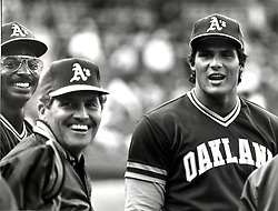 Oakland Athletics Mike Davis, Manager Jackie Moore, and Jose Canseco.(1986 photo/Ron Riesterer)