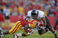 September 2 2010: Iowa State Cyclones running back Alexander Robinson (33) is tackled by Northern Illinois Huskies linebacker Alex Kube (37) during the first half of the NCAA football game between the Northern Illinois Huskies and the Iowa State Cyclones at Jack Trice Stadium in Ames, Iowa on Thursday September 2, 2010. Iowa State defeated Northern Illinois 27-10.