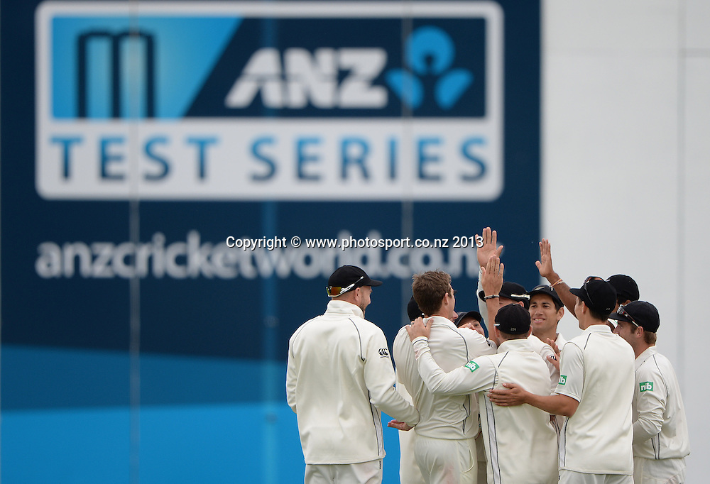Players celebrate the dismisal of Marlon Samuels on Day 3 of the 2nd cricket test match of the ANZ Test Series. New Zealand Black Caps v West Indies at The Basin Reserve in Wellington. Friday 13 December 2013. Mandatory Photo Credit: Andrew Cornaga www.Photosport.co.nz