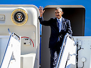 President Barack Obama arrives on Air Force One, Tuesday, Oct. 11, 2016, in Greensboro, N.C., for a town hall event hosted by ESPN at North Carolina A&T State University and a campaign rally for democratic presidential candidate Hillary Clinton. (AP Photo/Mike McCarn)