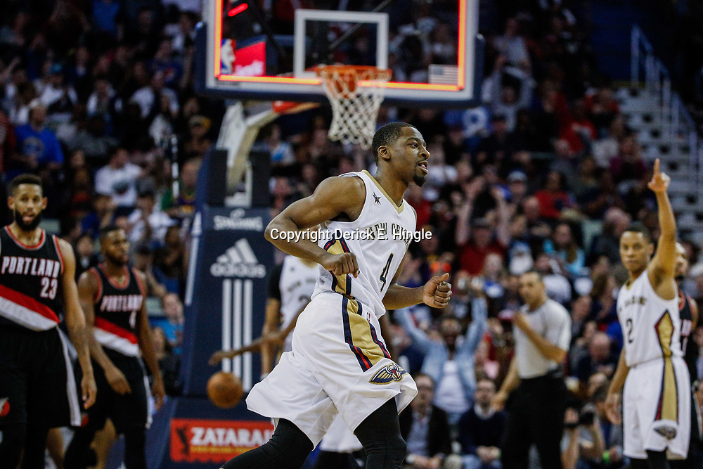 Mar 14, 2017; New Orleans, LA, USA; New Orleans Pelicans guard Jordan Crawford (4) celebrates after a three point basket against the Portland Trail Blazers during the second half of a game at the Smoothie King Center. The Pelicans defeated the Trail Blazers 100-77. Mandatory Credit: Derick E. Hingle-USA TODAY Sports